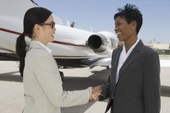 Business Colleagues Shaking Hands At Airfield Stock Photography