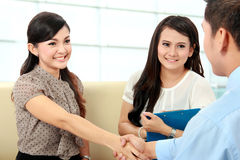Business colleagues shaking hands after interview Royalty Free Stock Photos