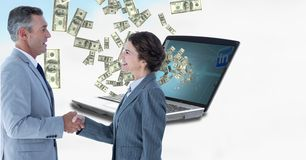 Business colleagues shaking hands with money in background. Digital composite of Business colleagues shaking hands with money in background Stock Images