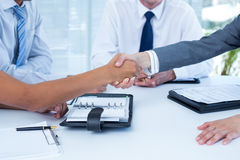 Business colleagues shaking hands Royalty Free Stock Image