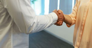 Business colleagues shaking hands in office stock video