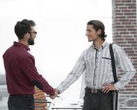 Business colleagues shaking hands at office. Photo with copy space royalty free stock photography