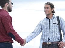 Business colleagues shaking hands at office. Photo with copy space royalty free stock image