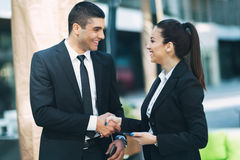 Business colleagues shaking hands Stock Images