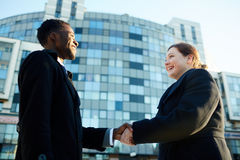 Business Colleagues Shaking Hands Outside Office Building Royalty Free Stock Photos