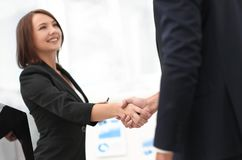 Business colleagues shaking hands after a successful presentation. Royalty Free Stock Images