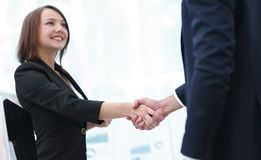 Business colleagues shaking hands after a successful presentation. Stock Photo