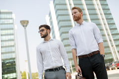 Business colleagues in shirt walking outdoors Royalty Free Stock Images