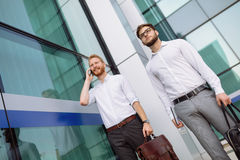 Business colleagues in shirt walking outdoors Stock Photo