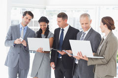 Business colleagues showing their multimedia devices to each other Royalty Free Stock Photo