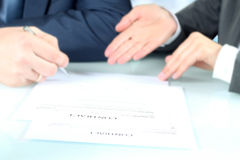 Business colleagues signing a contract Stock Images