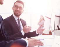 Business colleagues sitting at their Desk stock photos