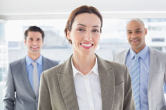Business colleagues smiling at camera Stock Photo