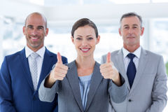 Business colleagues smiling at camera Royalty Free Stock Images