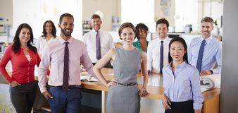 Business colleagues smiling to camera in office, panoramic royalty free stock photography