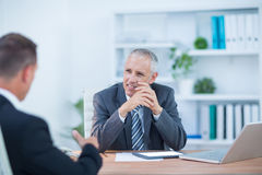Business colleagues smiling working together Royalty Free Stock Photos