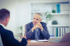 Business colleagues smiling working together Royalty Free Stock Photo