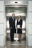 Business Colleagues Standing In Elevator Stock Photos