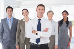 Business colleagues standing in a row Stock Image
