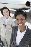 Business Colleagues Standing Together At Airfield Stock Images