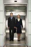 Business Colleagues Standing Together In Elevator Royalty Free Stock Photography