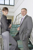 Business Colleagues Standing Together In Stairs In Office Stock Images