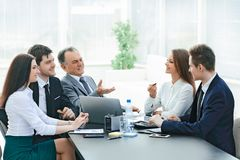 Business colleagues talking at Desk in the office. The concept of teamwork royalty free stock image