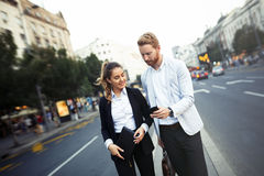Business colleagues talking outdoors Royalty Free Stock Images