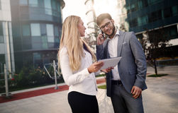 Business colleagues talking outdoors Stock Images