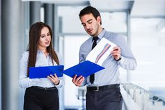 Business Colleagues Talking About Statistical Data. On Their Financial Reports Royalty Free Stock Photo