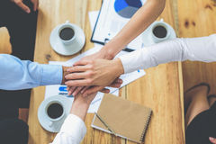 Business colleagues with their hands joined together Stock Photos
