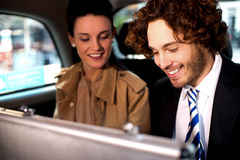 Business colleagues travelling together in taxi cab Royalty Free Stock Image
