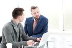 Business colleagues use a laptop to work in the office. royalty free stock images