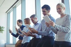 Business colleagues using digital tablets at office Royalty Free Stock Image