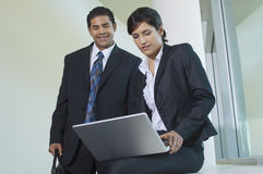 Business Colleagues Using Laptop Royalty Free Stock Photo