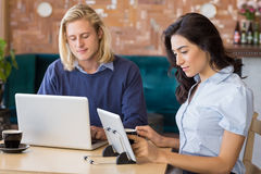 Business colleagues using laptop and digital tablet Royalty Free Stock Photos