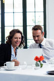 Business colleagues using a laptop while having a meeting Stock Images