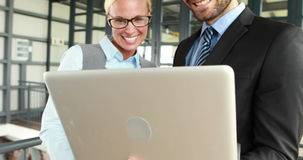 Business colleagues using laptop stock footage