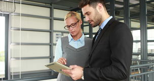 Business colleagues using tablet stock video