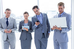 Business colleagues using their multimedia devices Stock Image