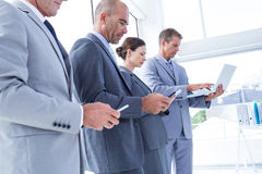 Business colleagues using their multimedia devices Royalty Free Stock Photography