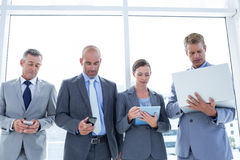 Business colleagues using their multimedia devices Royalty Free Stock Photo