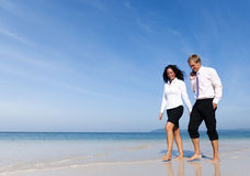 Business Colleagues walking on a beach Stock Photos