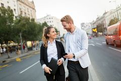 Business colleagues on city streets Stock Image