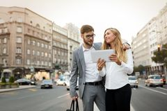 Business colleagues on city streets Stock Photo