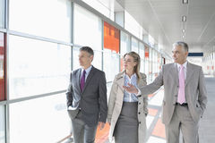 Business colleagues walking on train platform Stock Photos