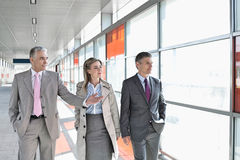 Business colleagues walking on train platform Stock Images