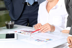 Business colleagues working and analyzing financial figures Royalty Free Stock Image