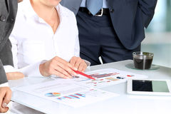 Business colleagues working and analyzing financial figures Royalty Free Stock Photography