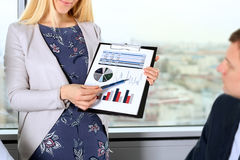 Business colleagues working and analyzing financial figures / graphs royalty free stock image